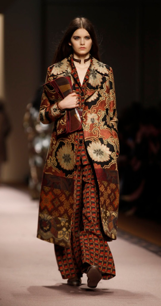 A model wears a creation for Etro women's collection, part of the Milan Fashion Week, unveiled in Milan, Italy, Friday, Feb. 27, 2015